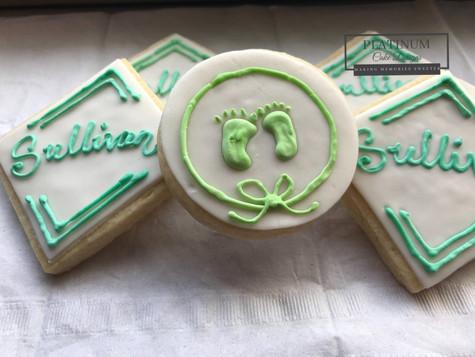 Custom sugar cookies created by Platinum Cake Designs in Decatur, GA for the christening of a sweet baby boy.  #makingmemoriessweeter #platinumcakedesigns #customcookies #sugarcookies #christening #decatur #atlanta #baptism #footprints