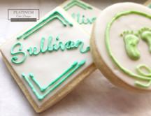 Closeup: Custom sugar cookies created by Platinum Cake Designs in Decatur, GA for the christening of a sweet baby boy.  #makingmemoriessweeter #platinumcakedesigns #customcookies #sugarcookies #christening #decatur #atlanta #baptism #footprints