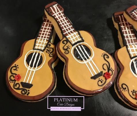 Custom guitar sugar cookies created by Platinum Cake Designs in Decatur, GA. #makingmemoriessweeter #platinumcakedesigns #sugarcookies #decatur #atlanta #guitar
