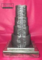Tiered wedding cake with edible silver lace and buttons to mimic wedding dress detail. Created by Platunum Cake Designs in our Decatur, Ga studio.  Making Memories Sweeter #platinumcakedesigns #decatur #fondant #wedding #silver #ediblelace #tieredcake