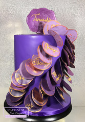 Double barrel birthday cake topped with a sugar placque and covered in purple fondant and edible inspirational words envelop the cake.  Created by Platunum Cake Designs in our Decatur, Ga studio.  Making Memories Sweeter #platinumcakedesigns #decatur #fondant #purple #birthdaycake #inspirational