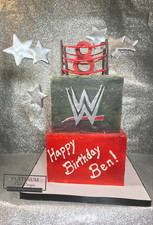 All buttercream 8th birthday wrestling cake with wrestling ring topper.  Created by Platunum Cake Designs in our Decatur, Ga studio.  Making Memories Sweeter #platinumcakedesigns #decatur #fondant #redcake #wwe #wrestlingcake #silverandredcake #birthdaycake #8thbirthday