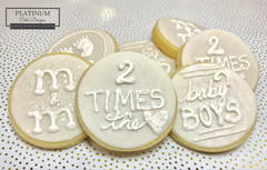 Custom sugar cookies created by Platinum Cake Designs in Decatur, GA to welcome twin baby boys. #makingmemoriessweeter #platinumcakedesigns #customcookies #sugarcookies #allwhite #decatur #atlanta #twins #twinboys #babyboy #babyshower