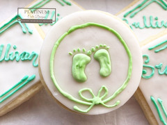 Closeup: Custom sugar cookies created by Platinum Cake Designs in Decatur, GA for the christening of a sweet baby boy.  #makingmemoriessweeter #platinumcakedesigns #customcookies #sugarcookies #christening #decatur #atlanta #baptism #footprints