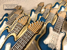 Custom sugar cookies created by Platinum Cake Designs in Decatur, GA for a  muscian's birthday to celebrate his love for his electric blue Stratocaster guitar. #makingmemoriessweeter #platinumcakedesigns #customcookies #sugarcookies #birthdaycookies #decatur #atlanta