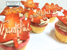 Maple leaves adorn these strawberry cupcakes for a special Thanksgiving Day family celebration.  Inscribed with the words 'grateful' and 'thankful'. #thanksgiving #fall #autumn #cupcakes #strawberry #platinumcakedesigns #makingmemoriessweeter #decatur #atlanta
