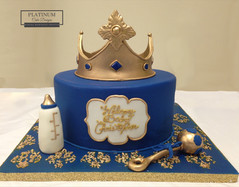 A little prince themed cake made especially for an expectant mother at her baby shower.  Created by Platunum Cake Designs in our Decatur, Ga studio.  Making Memories Sweeter #platinumcakedesigns #decatur #fondant #royalbabyshower #babyshowercake #crown #blue #birthdaycake