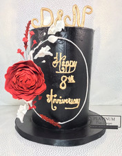 All black buttercream cake with red and white sugar flowers and a red sugar peony on a floral wreath  large red sugar peony.  The colors represent the Trinidadian flag.  Created by Platunum Cake Designs in our Decatur, Ga studio.  Making Memories Sweeter #platinumcakedesigns #decatur #fondant #wedding #anniversary #flowerhoop #doublebarrel #trinicake #floralhoop