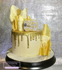 Off-white all buttercream cake with hand painted gold drip and gold chocolate sails and marbled fondant baseboard.   Created by Platunum Cake Designs in our Decatur, Ga studio.  Making Memories Sweeter #platinumcakedesigns #decatur #buttercream #birthday #chocolatesails #gold #singletier #atlanta