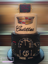 Inspired by his love for Cadillacs, we made this two-tiered 65th birthday cake covered in fondant. Created by Platunum Cake Designs in our Decatur, Ga studio.  Making Memories Sweeter #platinumcakedesigns #decatur #fondant #65thbirthday #cadillaccake #carcake #birthdaycake