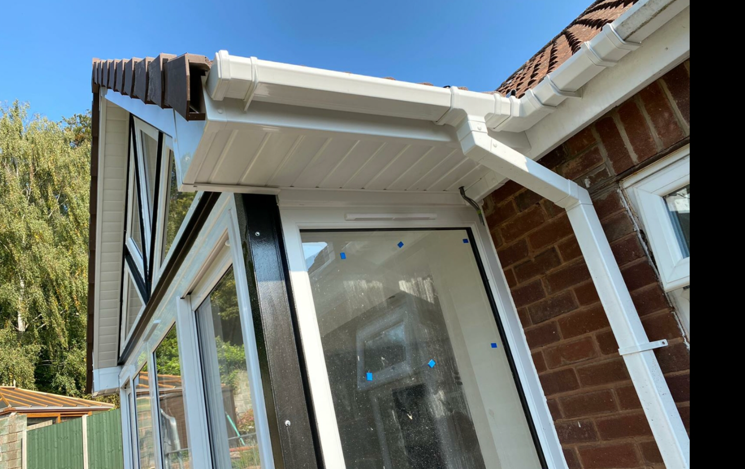 You will see the new fascia, soffit, guttering and down pipe fitted and connected to the original part of the bungalow.