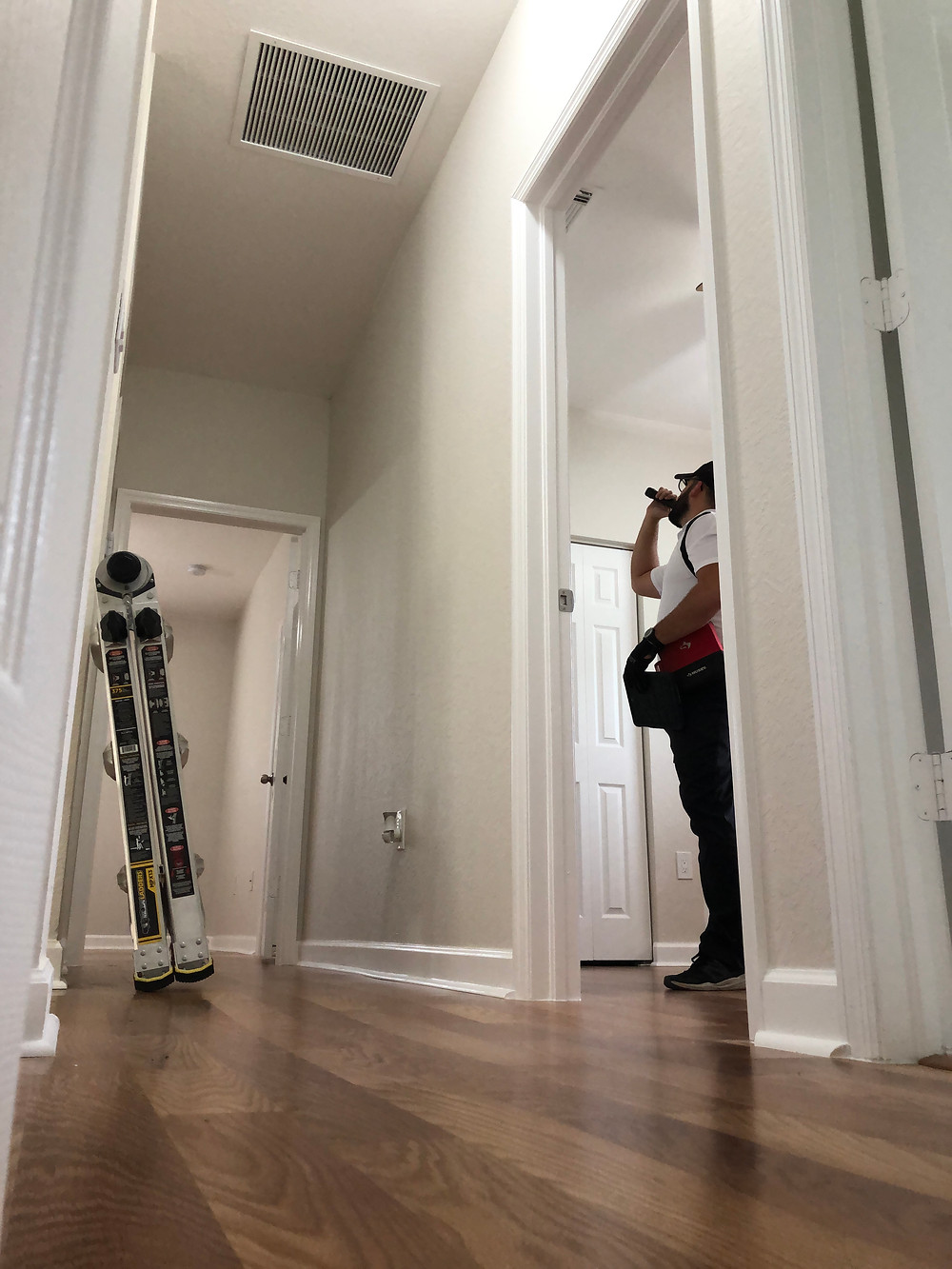 One of CR Pro Home Inspection's inspectors inspecting