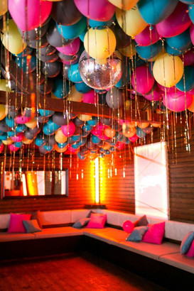 Up and Away: How to Masterfully fill a Ceiling with Balloons