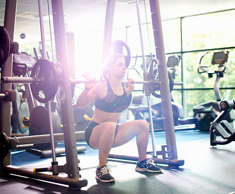 Medowie Physio | Woman Lifting Weights | Gym Rehab |