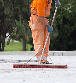 Construction worker sweeping on the buil