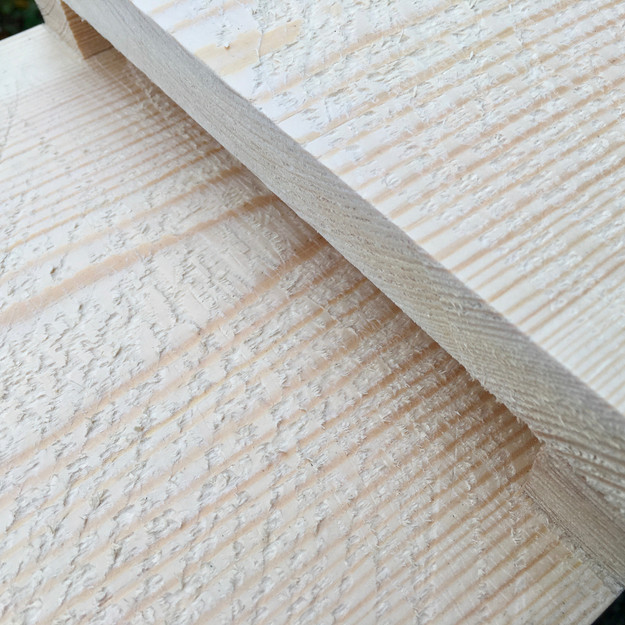 Roughened wood to provide a good grip for bats