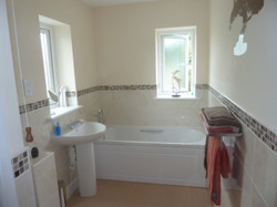 Bathroom tiling and new suite