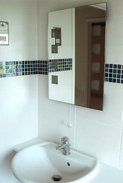 Backlit mirror with new tiles
