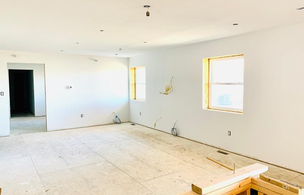 living area from kitchen towards bedroom