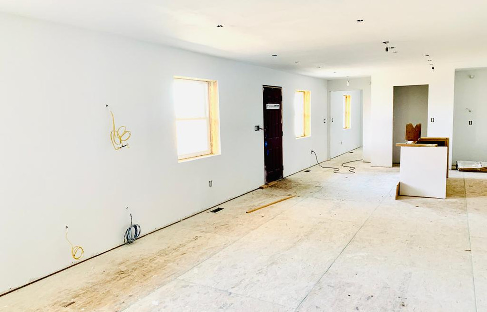 living area towards kitchen and exterior