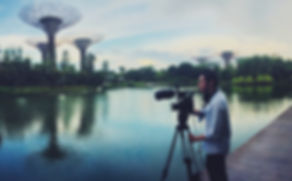 Reece Lipman hard at work, filming in Singapore