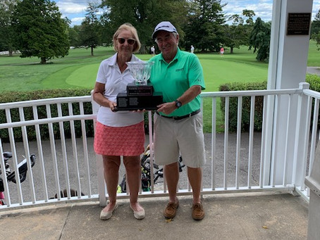MCMULLAN'S TAKE SPOUSE CHAMPIONSHIP WITH 68