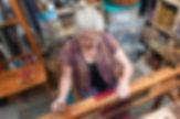 Jenny weaving in her Studio.