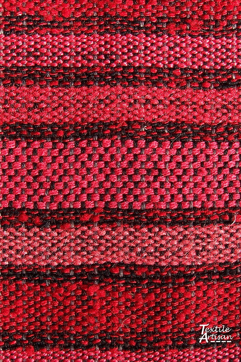 Handspun handwoven red silk tasselled scarf close up