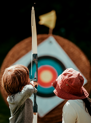 Child%20learning%20archery_edited.png