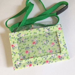 Blue and pink on green, with lanyard