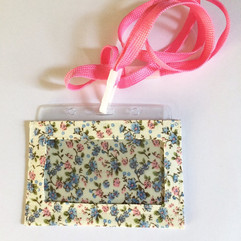 Blue and pink on cream, with lanyard