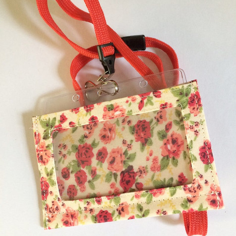 Red on cream, with lanyard