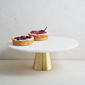 marble and brass cake stand