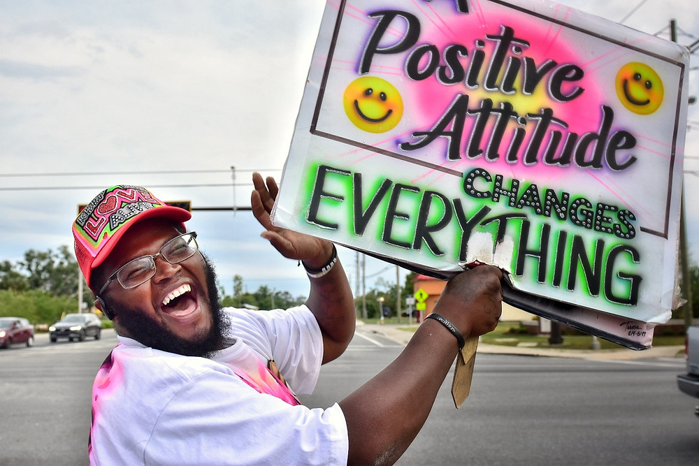 Decaris Hunter poses with his sign, April 15th, 2020, Panama City, Fl. (Photo by Dylan Gentile)