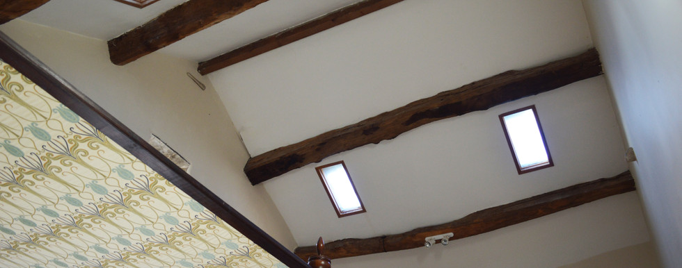 HIGH CEILINGS AND EXPOSED BEAMS