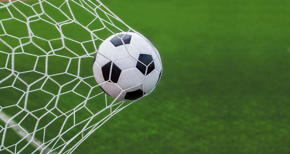 Soccer-ball-in-goal-scaled.jpeg