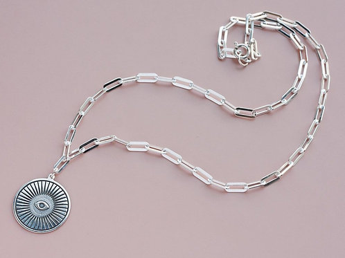 Pendant on a chain with an eye // silver