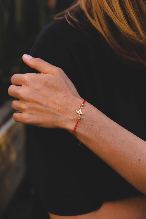 Bracelet on red thread with a bird // gold filled