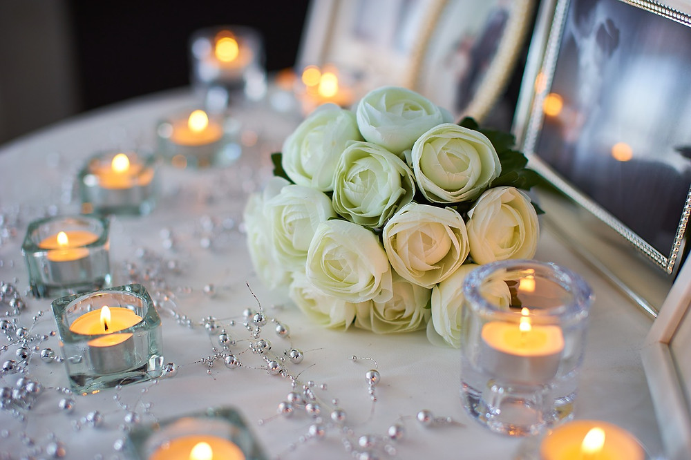 Wedding centerpiece with candles and beads
