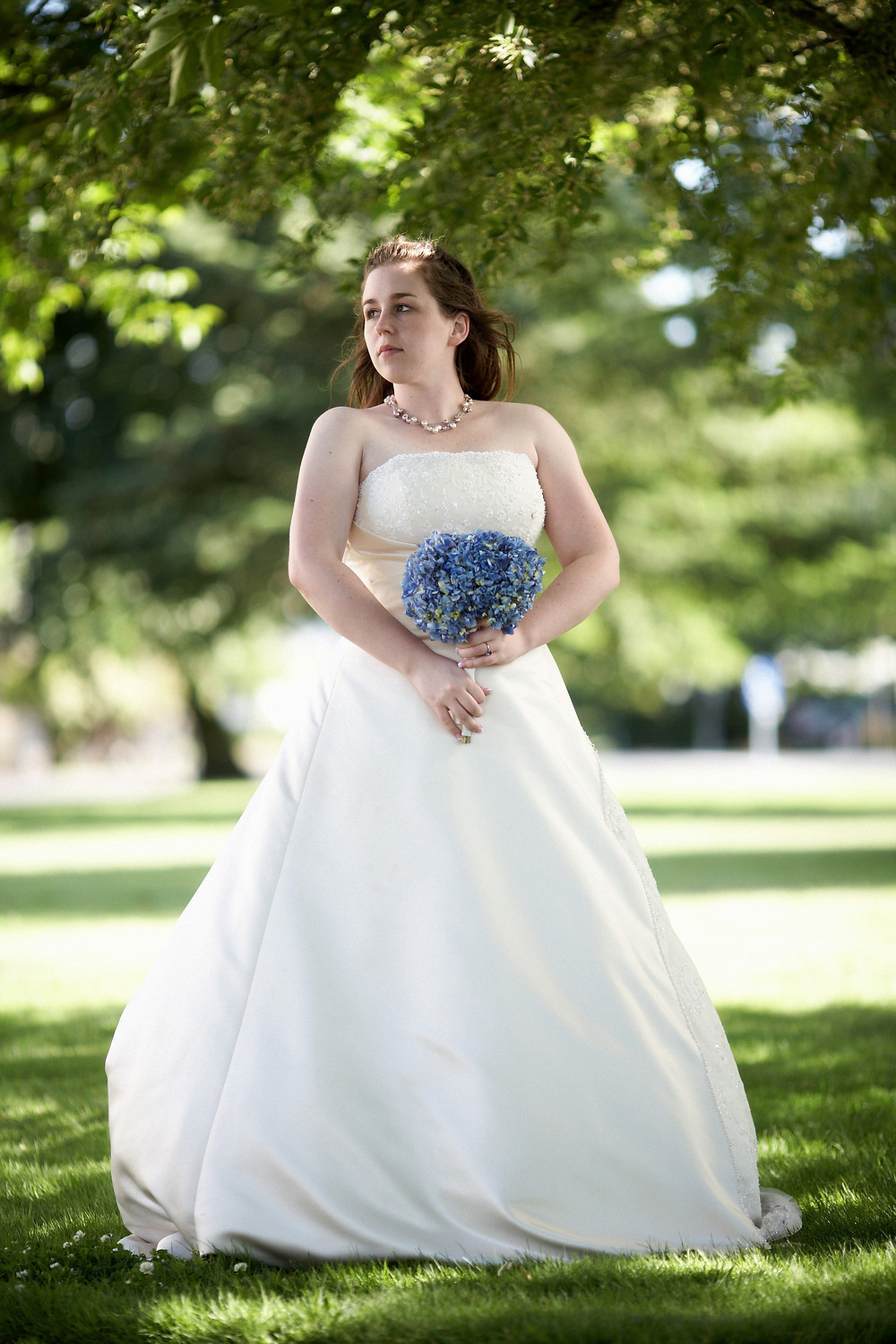 Bride is strapless wedding gown