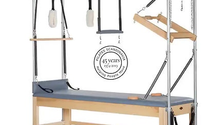 Marjon works with the beautiful equipment of Pilates Scandinavia