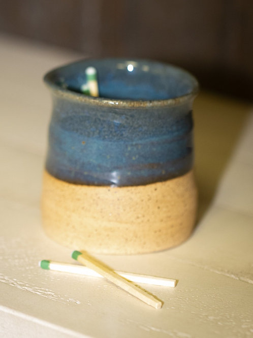 Match cup with strike base in blue
