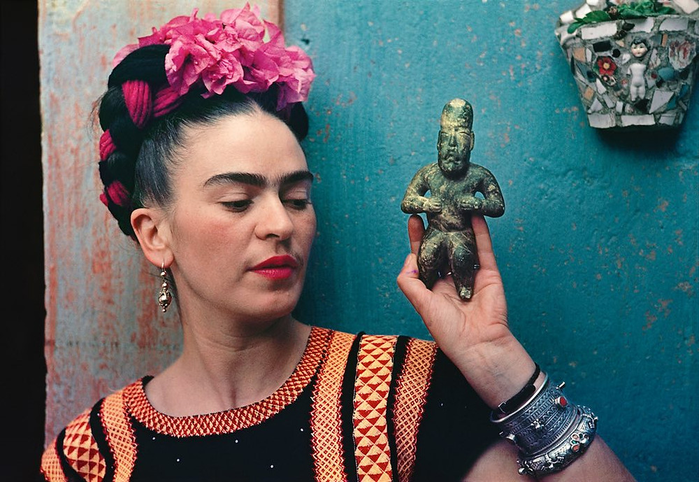 Frida with Olmeca Figurine, Coyoacán 1939