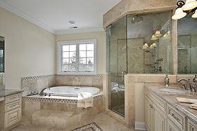Stunning Remodeled Bathroom with Frame-less Shower Door