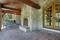 Stunning Covered Patio with Rock Fireplace