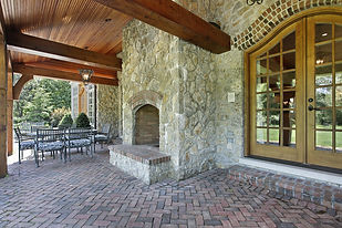 wood beams and stone fireplace