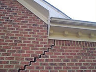 Large crack on side of Brick Home caused by Foundation problems