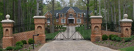 Beautiful Entrance Gate in front of Custom Home