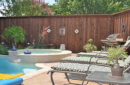 Beautiful wood Privacy Fence surrounding pool