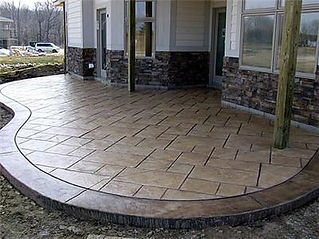small, under deck, stamped concrete patio